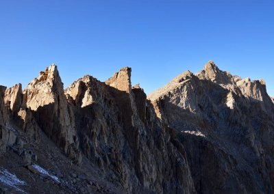 Towering granite against the dark blue sky